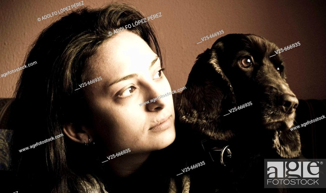Stock Photo: Young woman with dog.