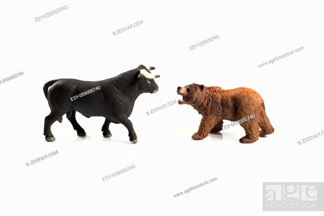 Photo de stock: Stock market, securities trading and capitalism concept with a bull and bear concepts. On white background for cutout and copy space.