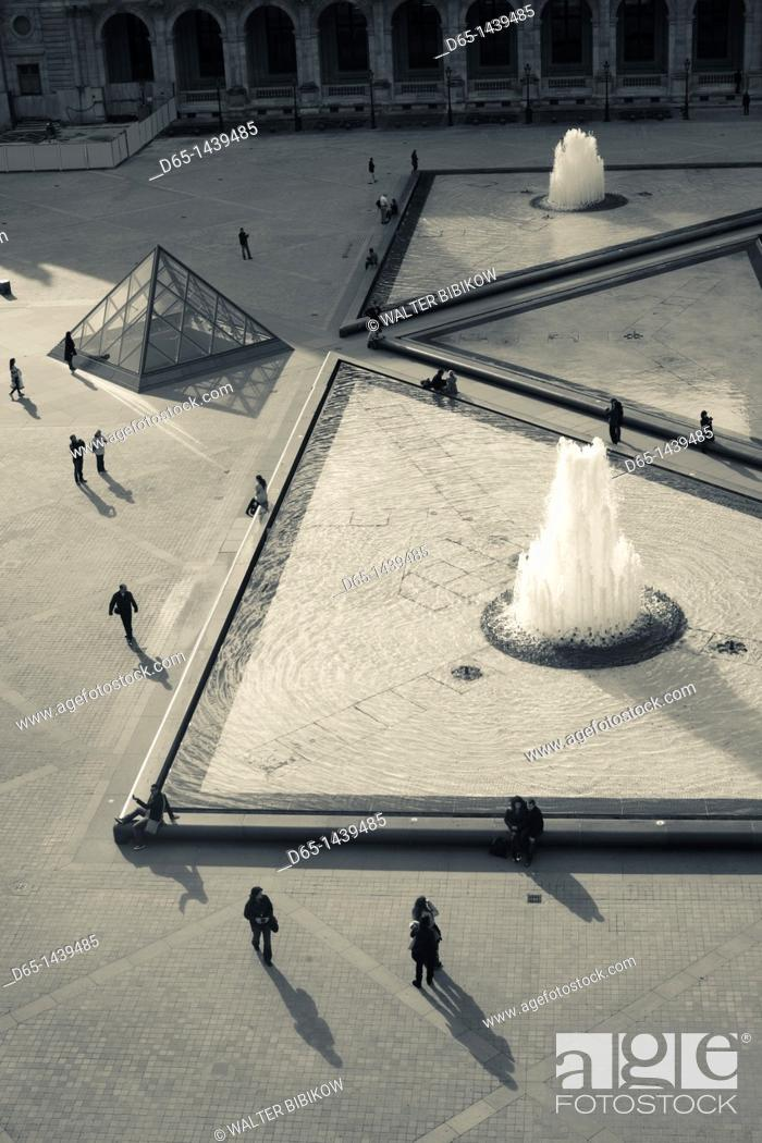 Stock Photo: France, Paris, Musee du Louvre museum, elevated view of Louvre Pyramid courtyard.