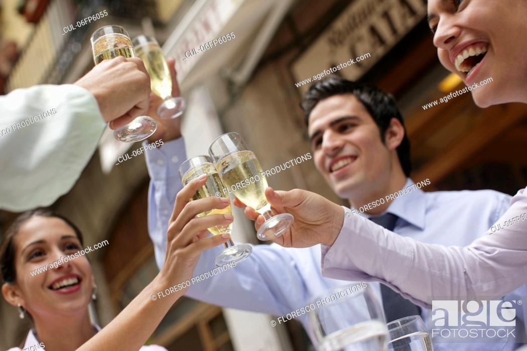 Stock Photo: Business team toasting each other.