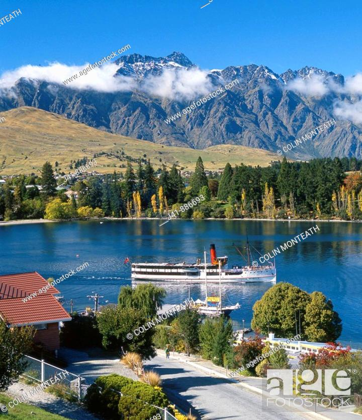 Stock Photo: Earnslaw leaving Queenstown Bay Remarkables behind New Zealand.