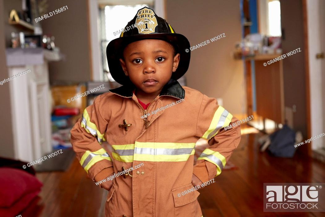 Stock Photo: Black boy wearing firefighter Halloween costume.
