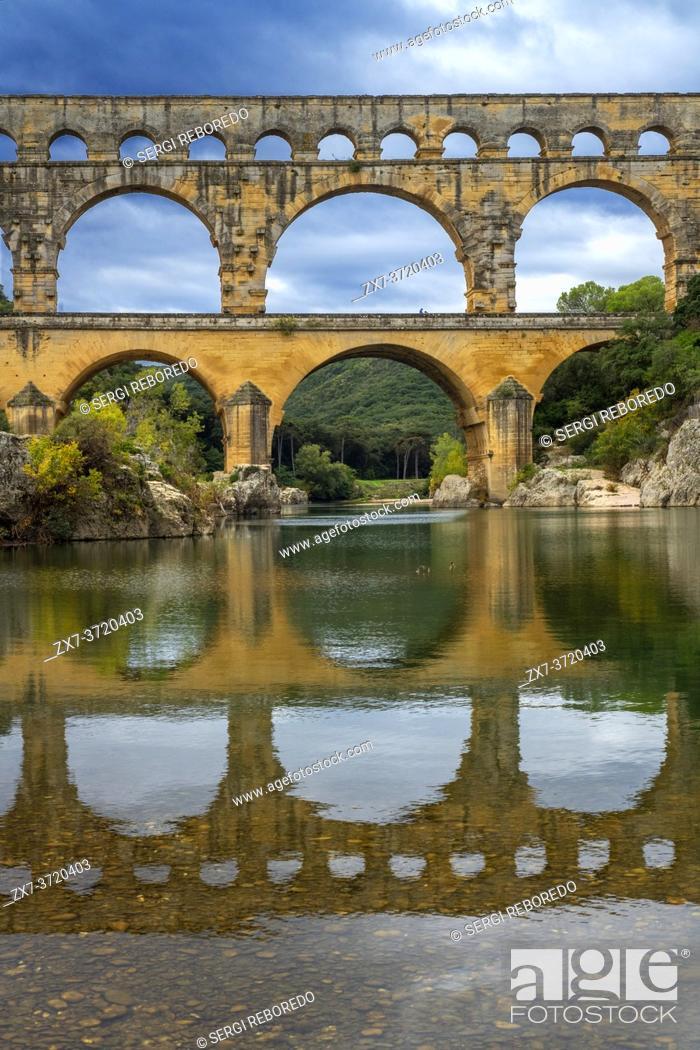 Stock Photo: Pont du Gard, Languedoc Roussillon region, France, Unesco World Heritage Site. Roman Aqueduct crosses the River Gardon near Vers-Pon-du-Gard.