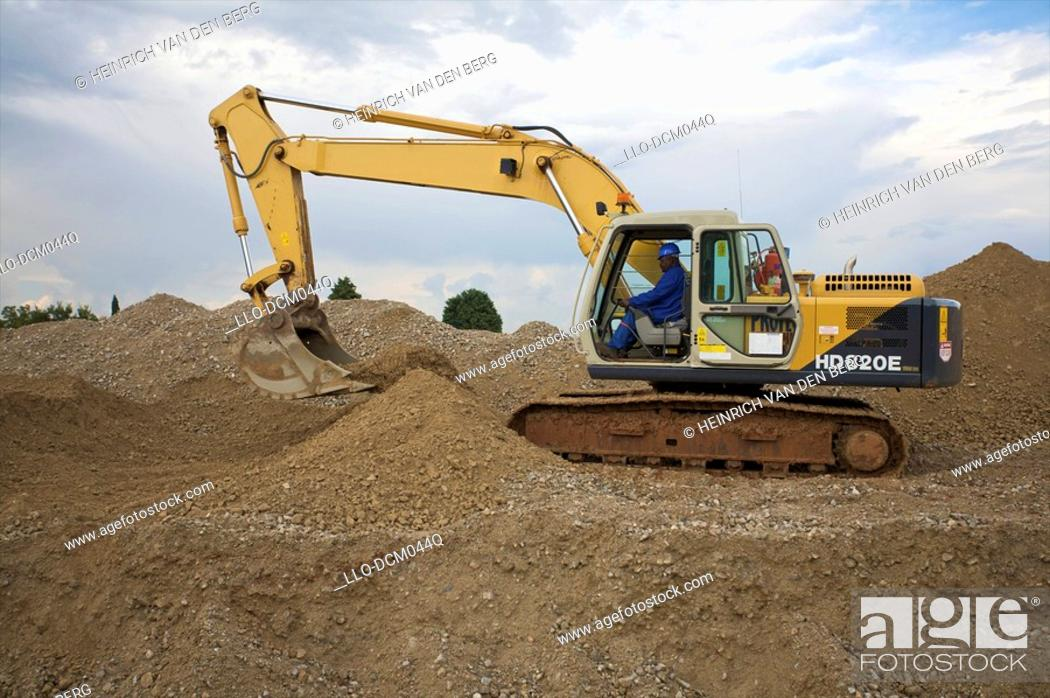 Stock Photo: Side view of excavator at construction site, Johannesburg, Gauteng, South Africa.