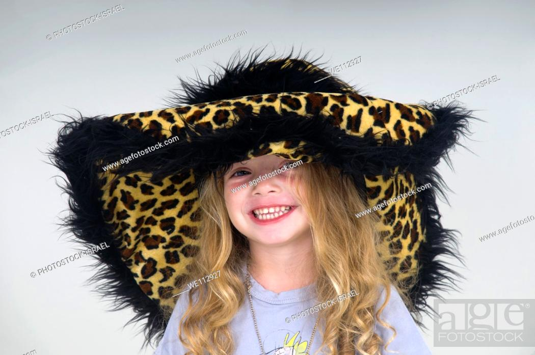 Stock Photo: Smiling young girl of three with leopard fur hat.