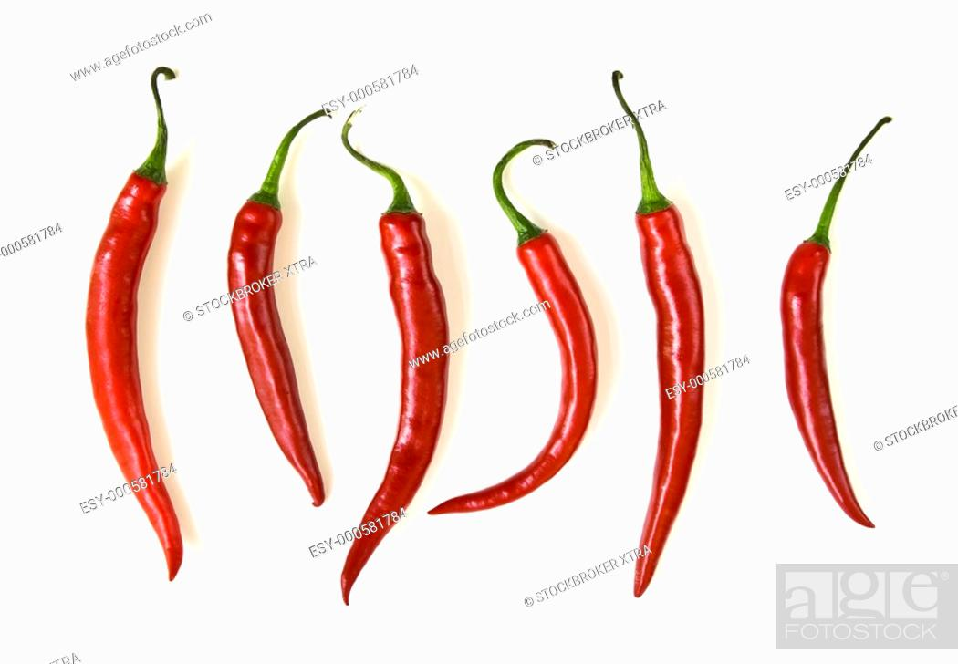 Stock Photo: Red hot chilli peppers isolated on white background.