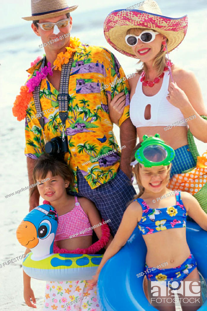 Stock Photo: Father and mother with their children at the beach.