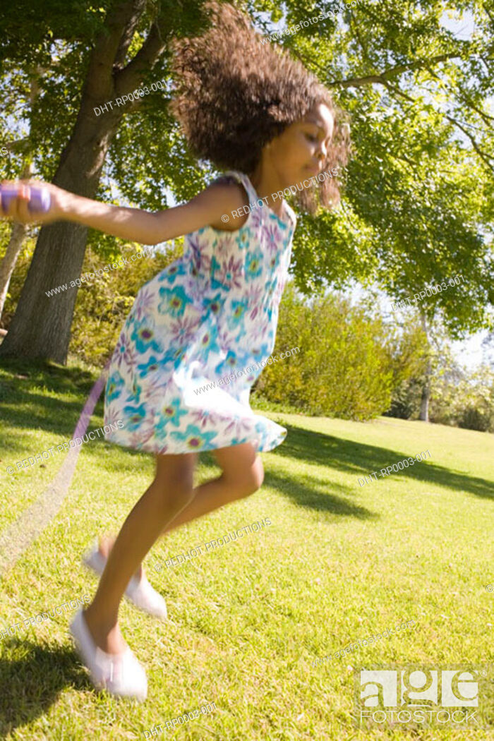 Stock Photo: Girl with skipping rope.