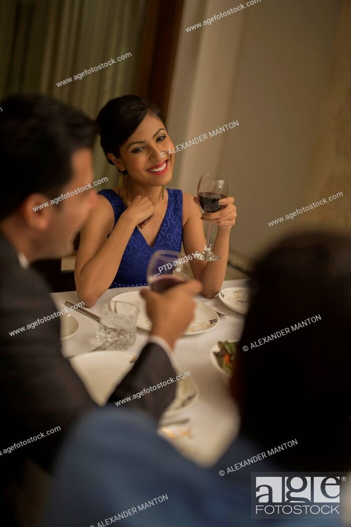 Stock Photo: Woman at formal dinner with wine glass.