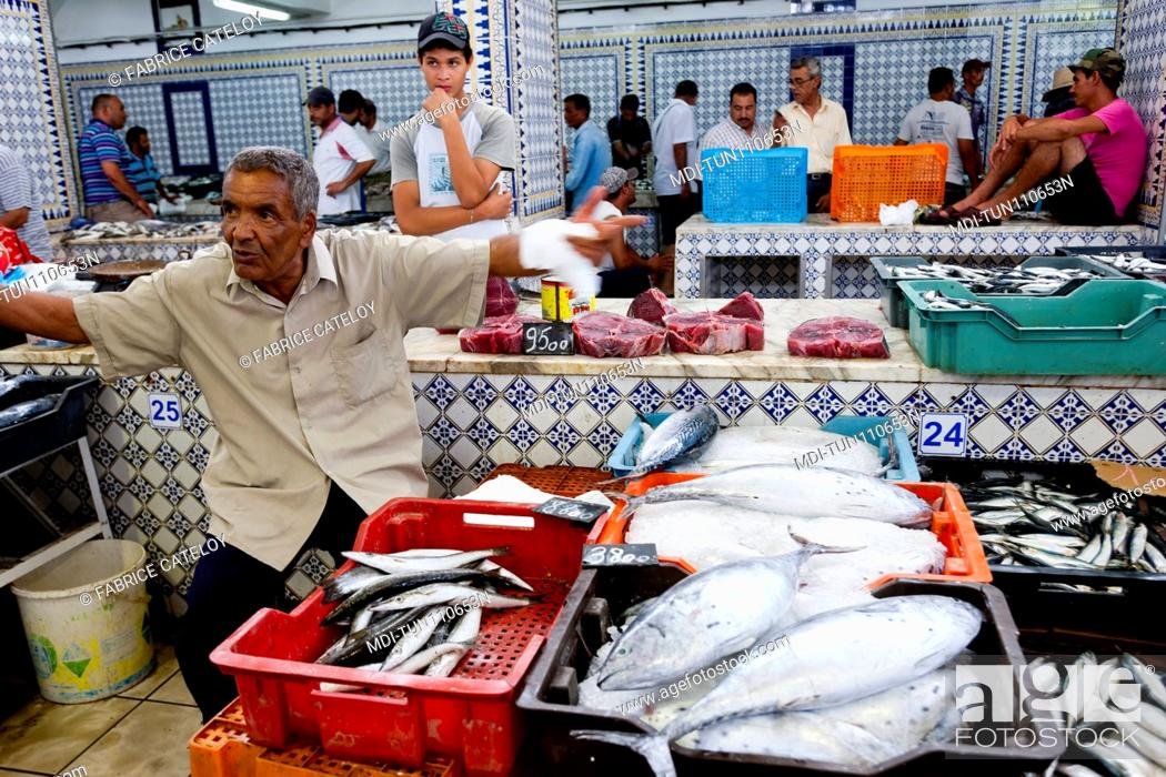 Stock Photo: Tunisia - Madhia - Fish market - Man selling fishes.