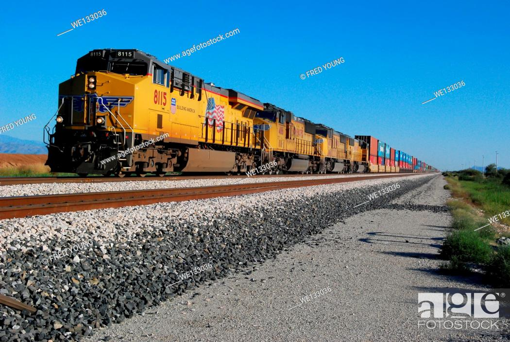 Stock Photo: Picacho, AZ, USA - October 24, 2014: Approaching freight train loaded with cargo.