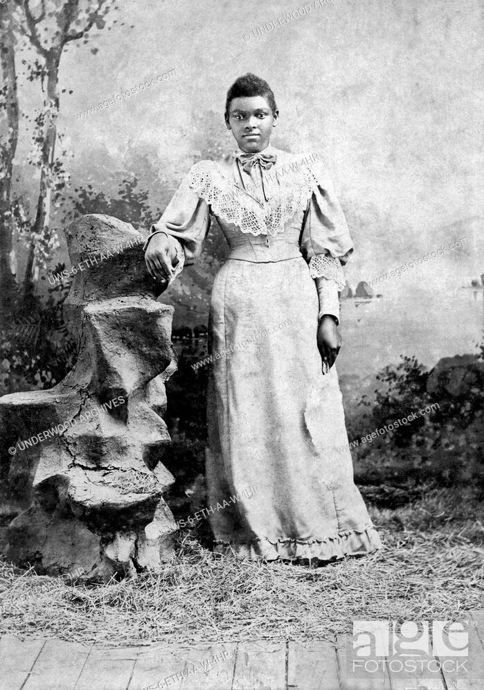 Stock Photo: Jackson, Mississippi: c. 1890.A studio portrait of a young African American woman with her arm resting on a carved stump.