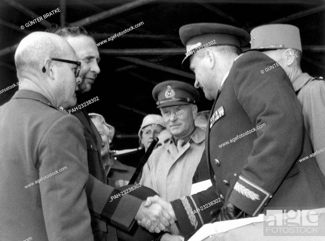 Stock Photo: General H. I. Hodes (l), commander-in-chief of the US Army in Europe, welcoming the Soviet town major General H. F. Zakharov (r) during a parade on occasion of.