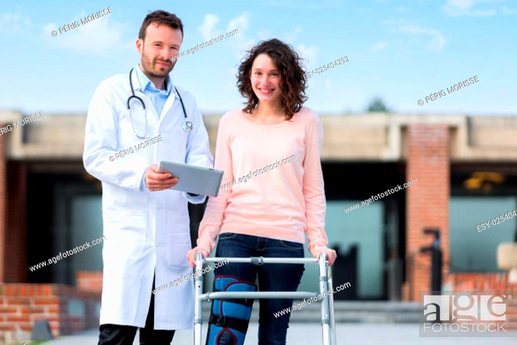 Stock Photo: View of a Doctor showing reeducation's tips on tablet.