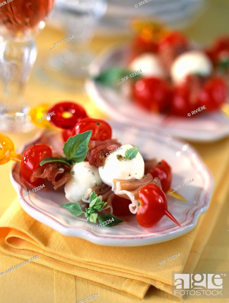 Stock Photo: Cherry tomato,feta and raw ham brochettes.