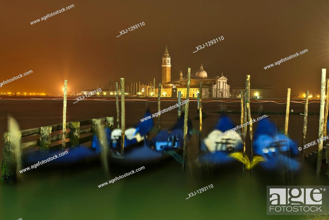 Stock Photo: Gondolas at night, Venice, Italy.