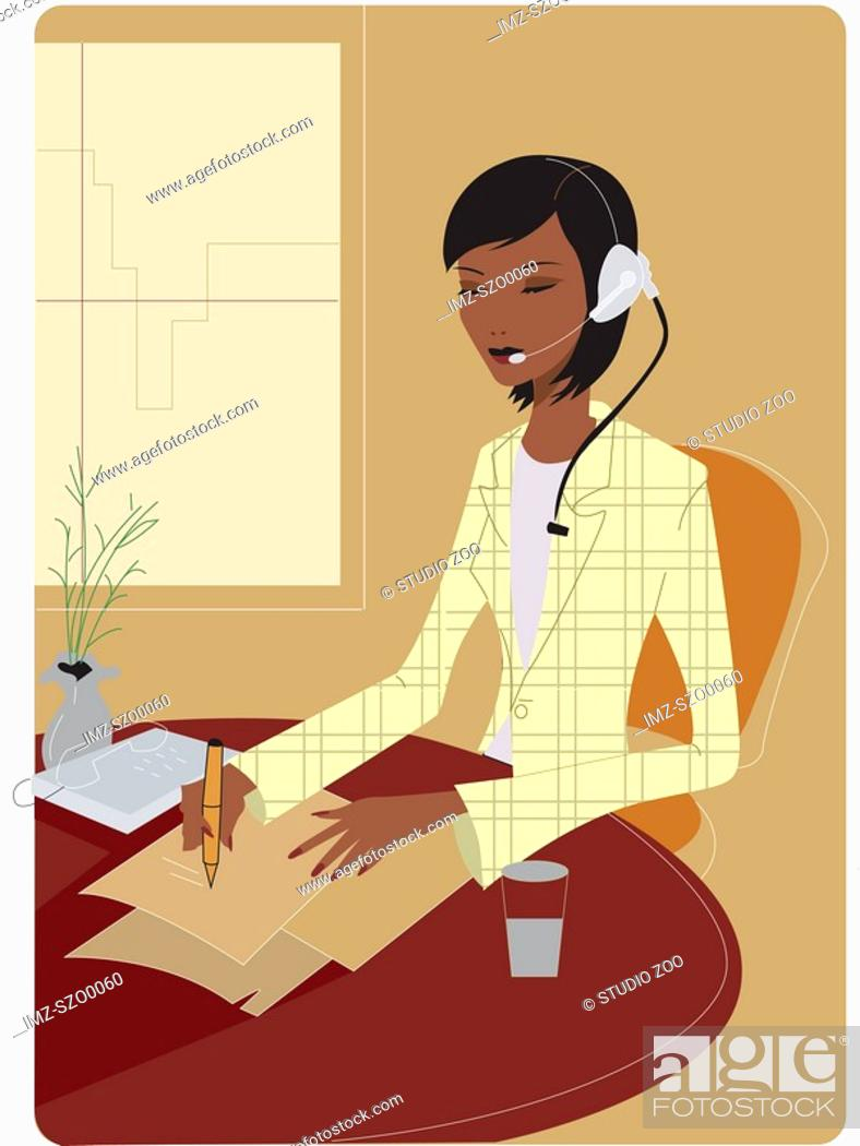 Stock Photo: Businesswoman wearing a telephone headset and taking notes.