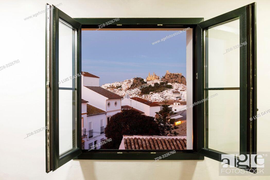 Imagen: panoramic with nuestra señora de la encarnacion church ant the castle throught the window. olvera, cadiz, SPAIN.