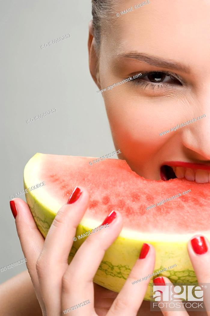 Stock Photo: Young woman eating watermelon.