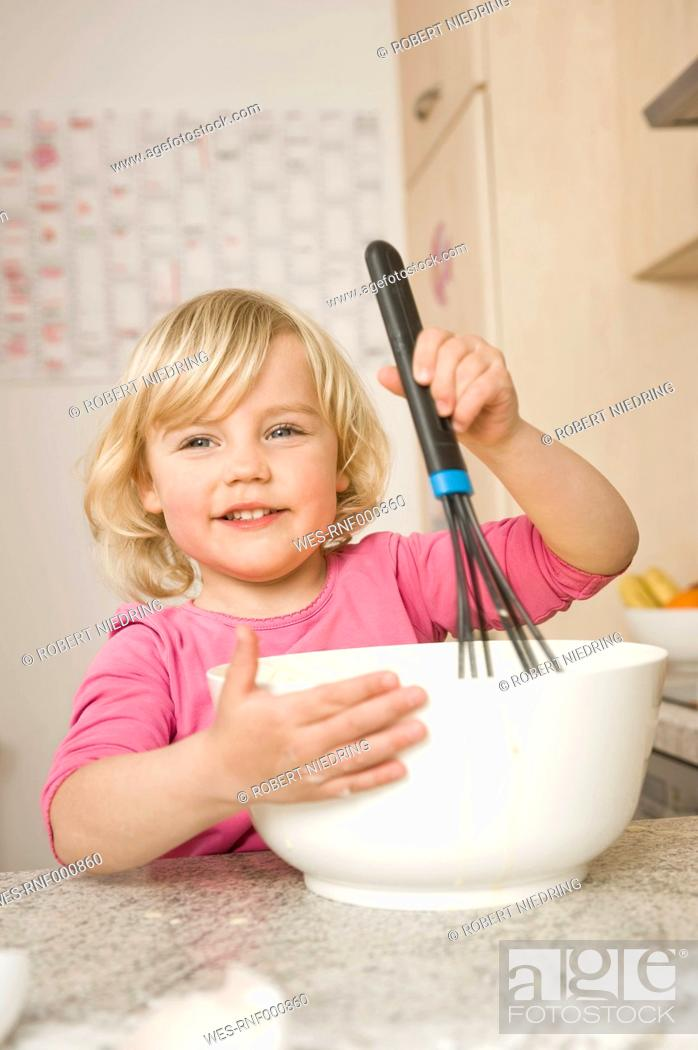 Stock Photo: Girl mixing cake ingredients in bowl.