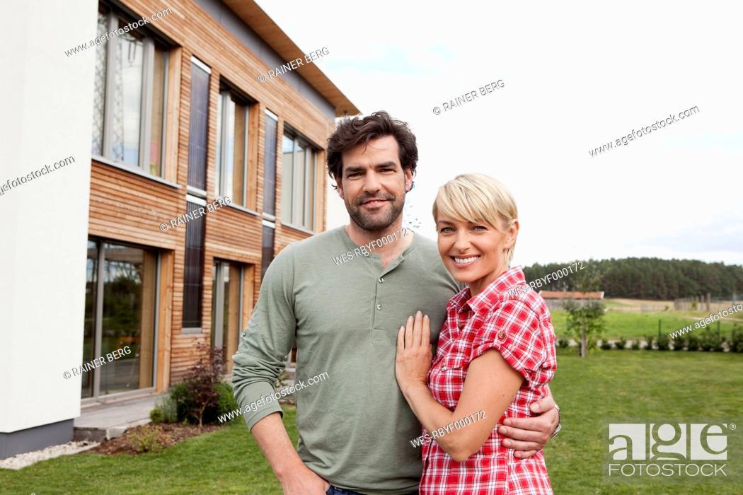 Stock Photo: Germany, Bavaria, Nuremberg, Mature couple smiling, portrait.