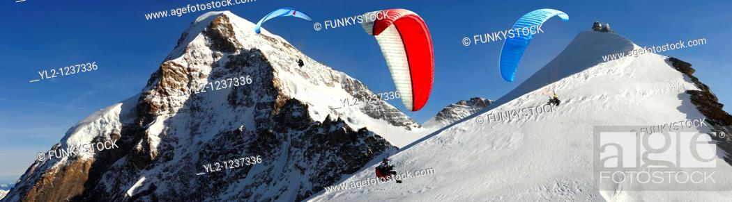 Stock Photo: Paragliders near the Observatory at the Jungfrau Top of Europe - Swiss Alps - Switzerland.