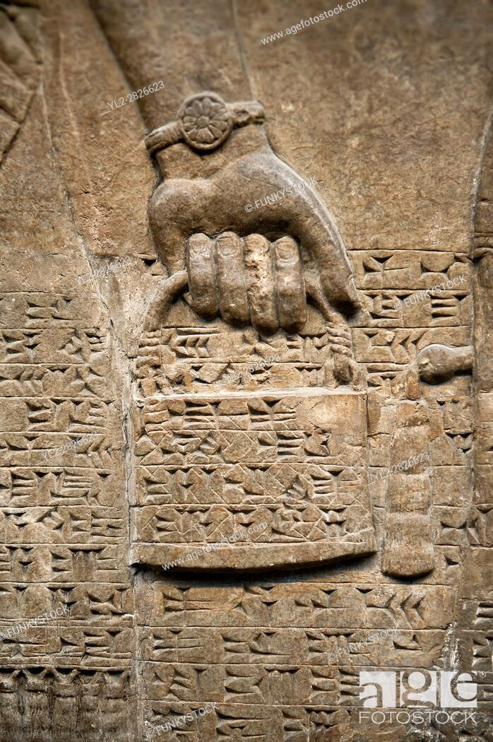 Stock Photo: Assyrian relief sculpture panel detail of a hand holding a bucket of holy water. From Nimrud, Iraq, 865-860 B. C North West Palace.