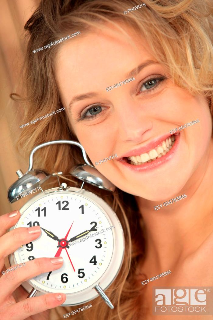 Stock Photo: Blonde Woman holding alarm clock.