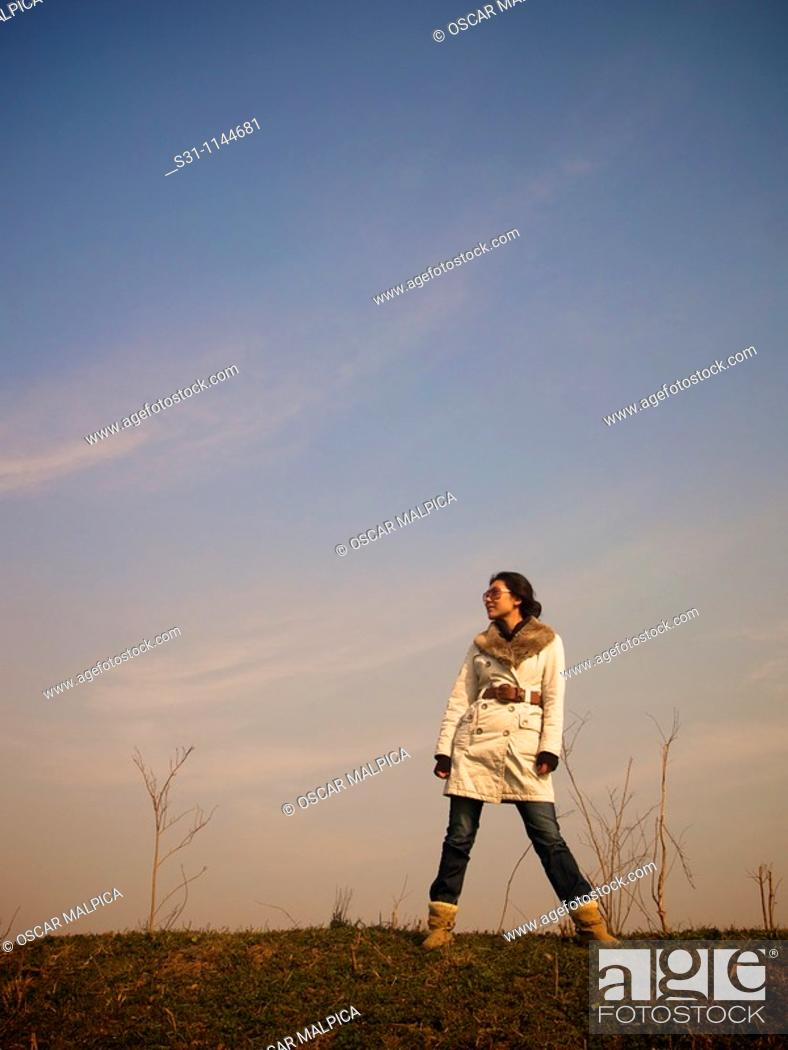 Stock Photo: young chinese woman visiting the 2010 shanghai expo.