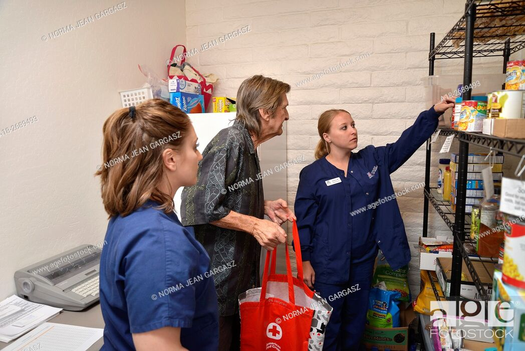 Stock Photo: University of Arizona College of Nursing students review food labels with a Miracle Square resident at the pantry of the facility.
