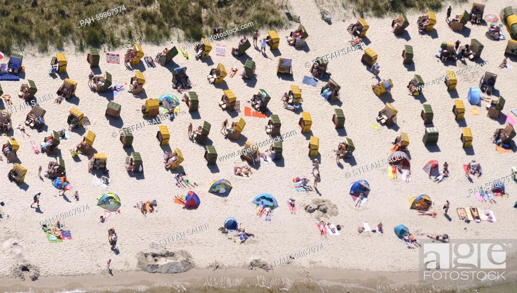Stock Photo: Beach chairs lined up in rows at summerly weather, ready for the guests at the Baltic Sea beach of Binz (Mecklenburg-Western Pomerania), Germany, 01 July 2015.
