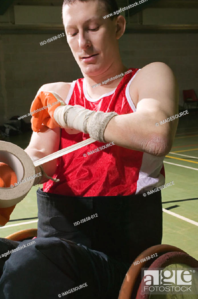 Stock Photo: Basketball player bandaging his arm.