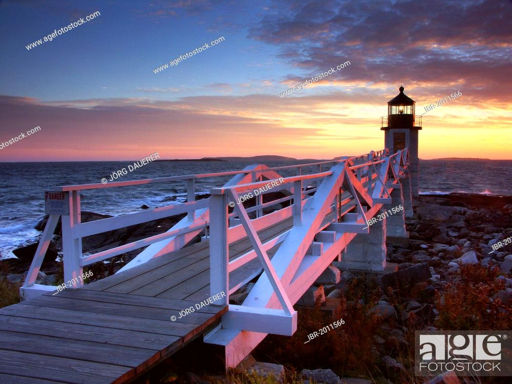 Stock Photo: Spectacular sunset behind Marshall Point Lighthouse in Port Clyde, Maine, USA.