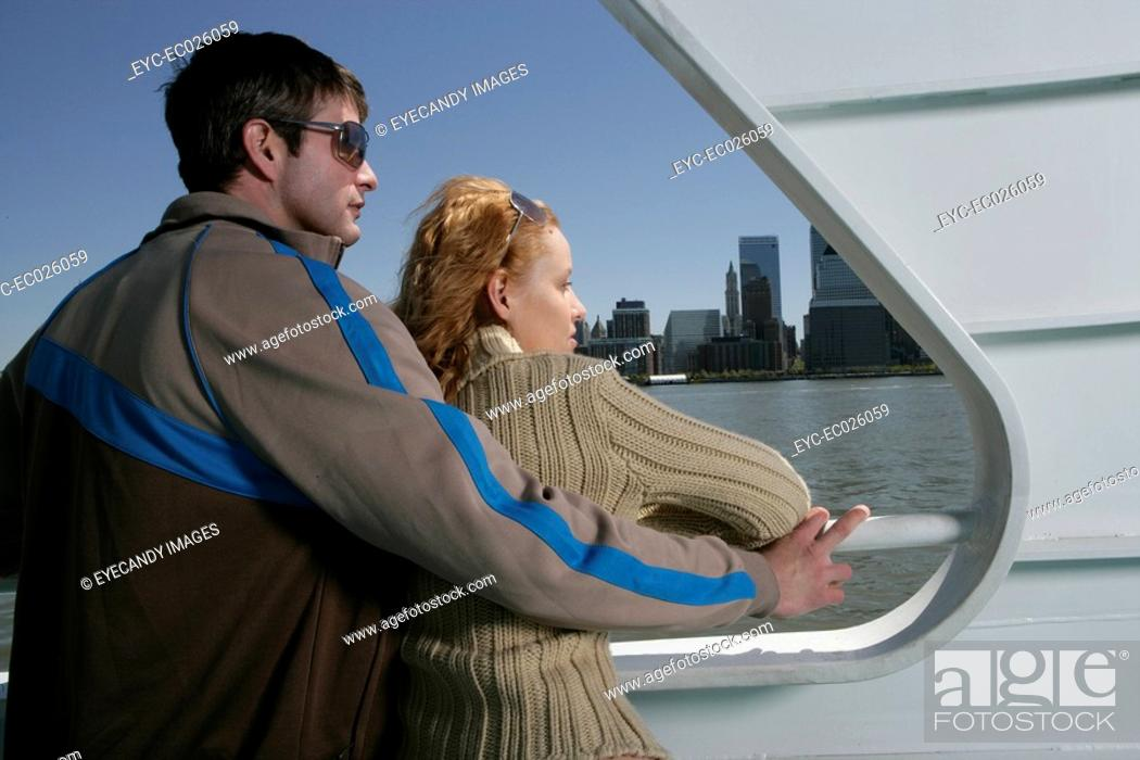 Stock Photo: Couple standing together on a boat.