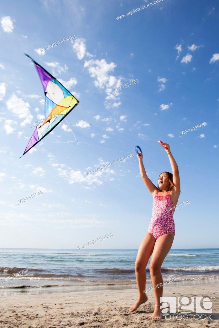 Stock Photo: girl flying a kite.