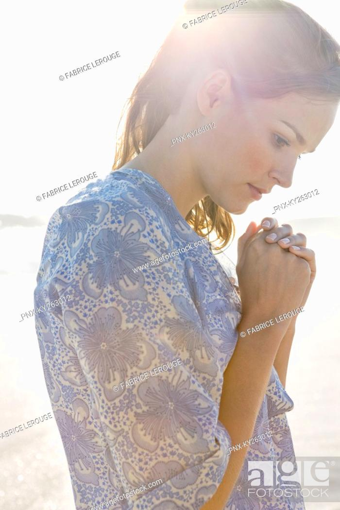 Stock Photo: Close-up of a woman praying.