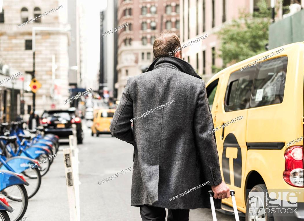 Stock Photo: USA, New York City, businessman on the move in Manhattan.