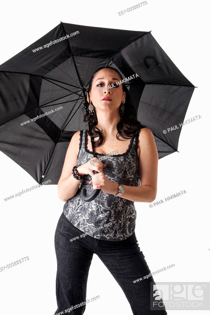 Stock Photo: Beautiful caucasian woman with umbrella and attitude, isolated.