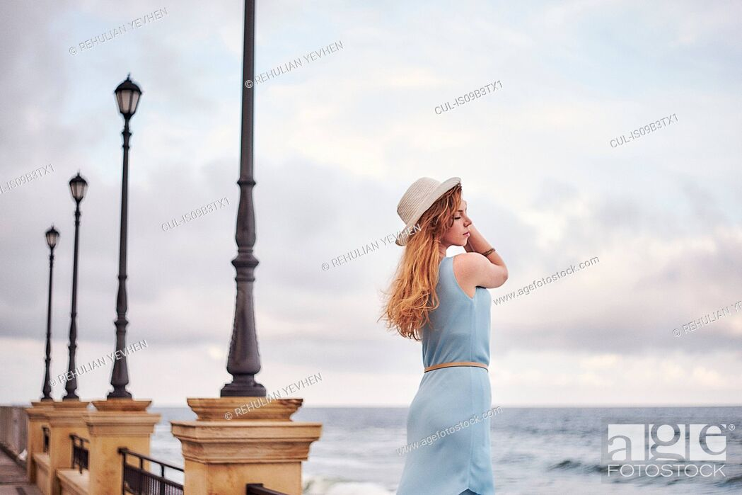 Stock Photo: Woman looking out to sea.