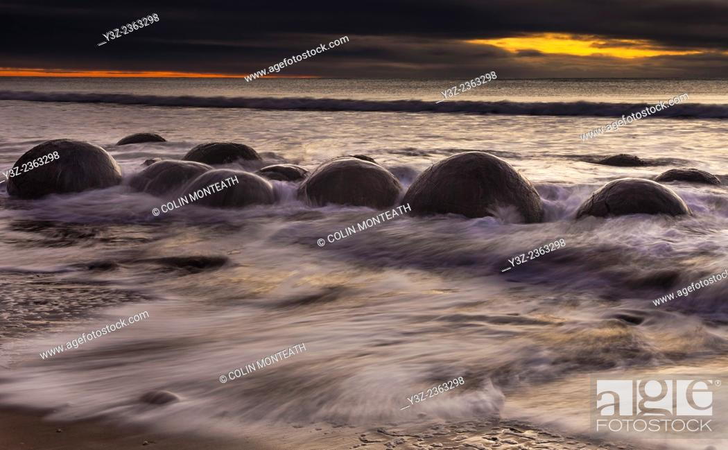 Stock Photo: Winter dawn, Moeraki boulders, Otago, New Zealand.