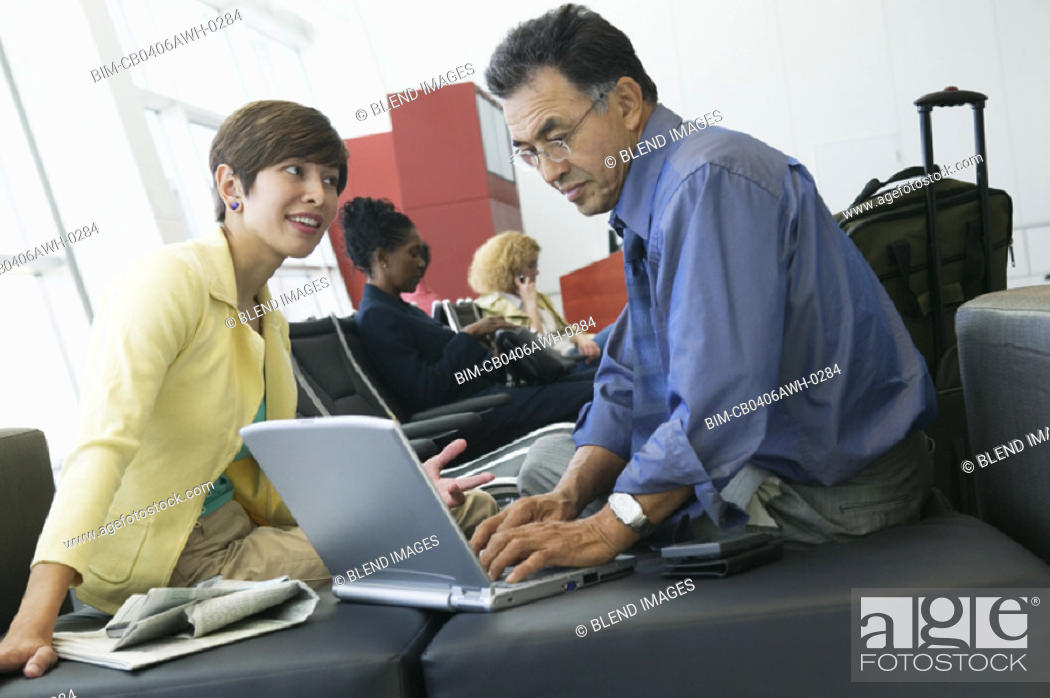 Stock Photo: Businesspeople with laptop.