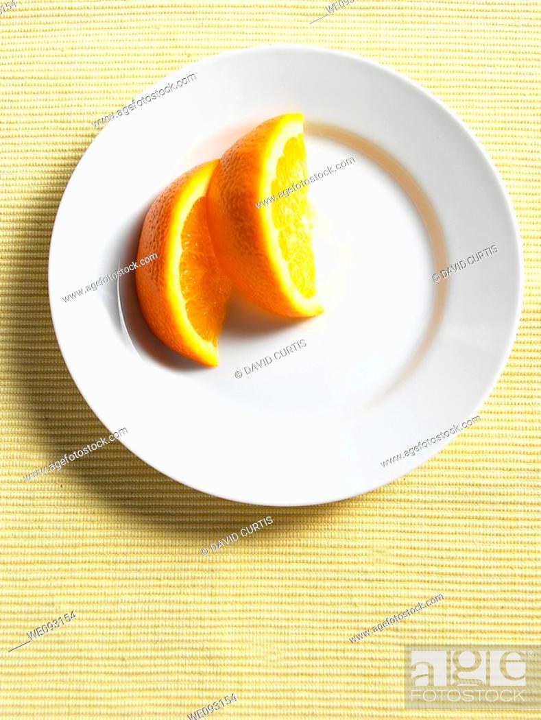 Stock Photo: Orange segments on a plate.