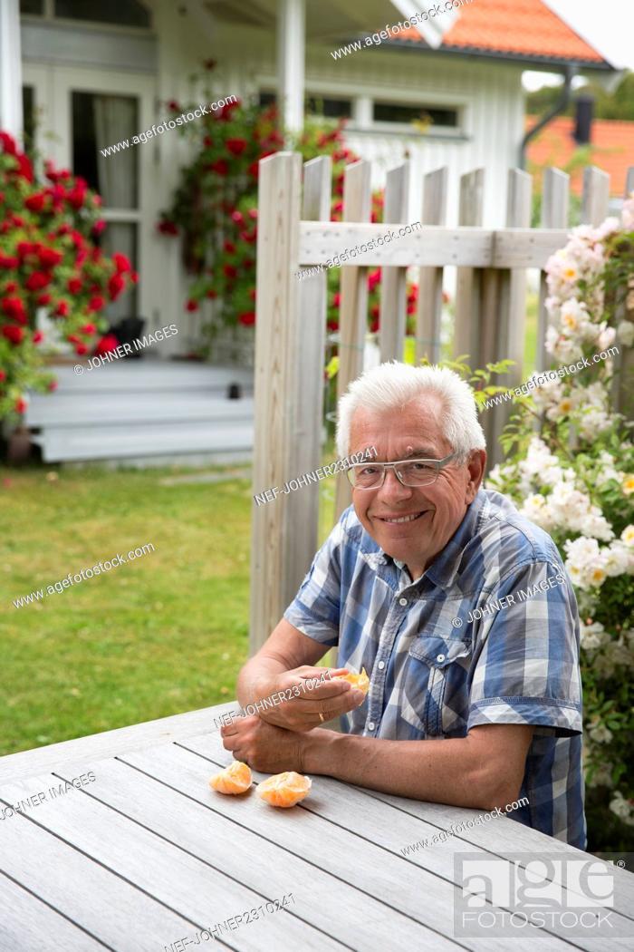 Stock Photo: Senior man sitting in garden.