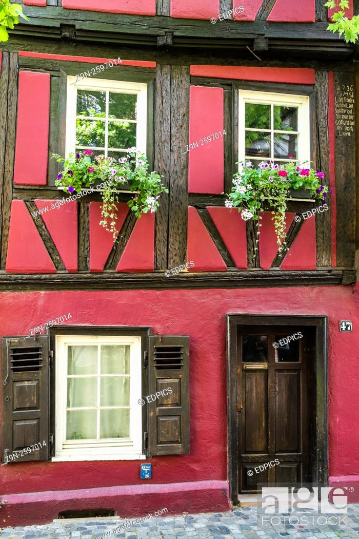 Stock Photo: flower decked facade of a historic half timbered building in the historic part of esslingen, baden-wuerttemberg, germany.
