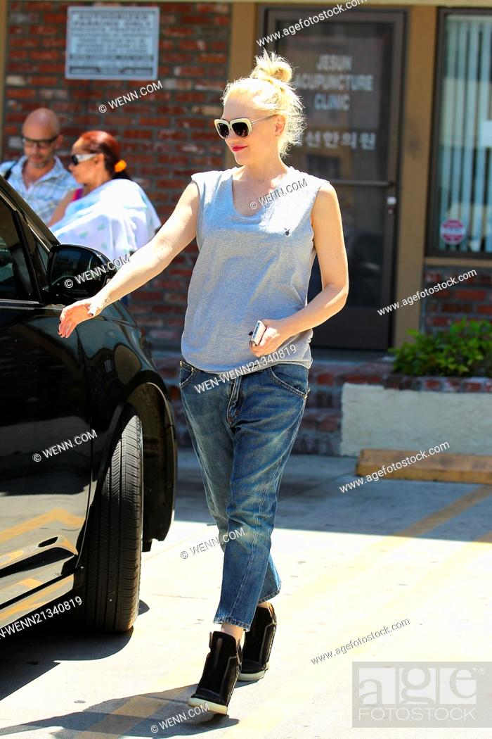 6a9e898d18898 Stock Photo - Gwen Stefani in loose-fitting tank top and jeans leaving goes  for an acupuncture session at Jesun Acupuncture Clinic in Los Angeles  Featuring  ...