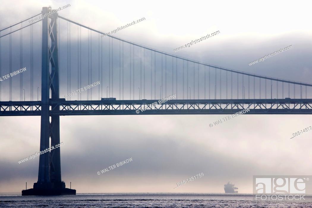 Stock Photo: USA, California, San Francisco, Embarcadero, Bay Bridge in fog.