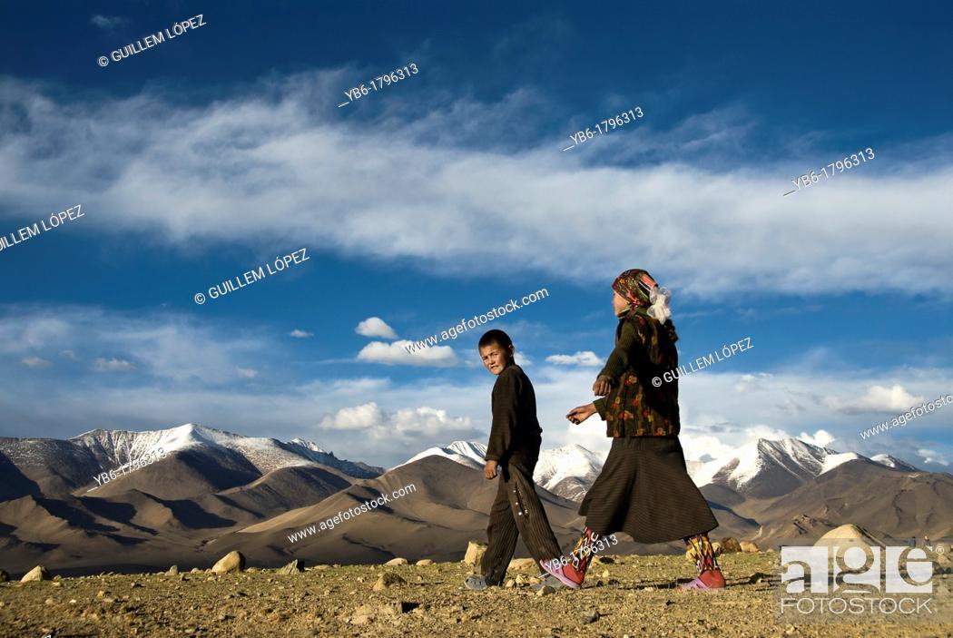 Stock Photo: Shepherd kids, Karakul Lake, Tajikistan.