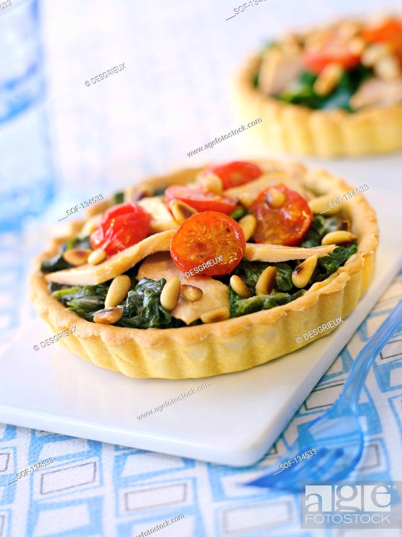 Stock Photo: Tuna,tomato and spinach tartlet.