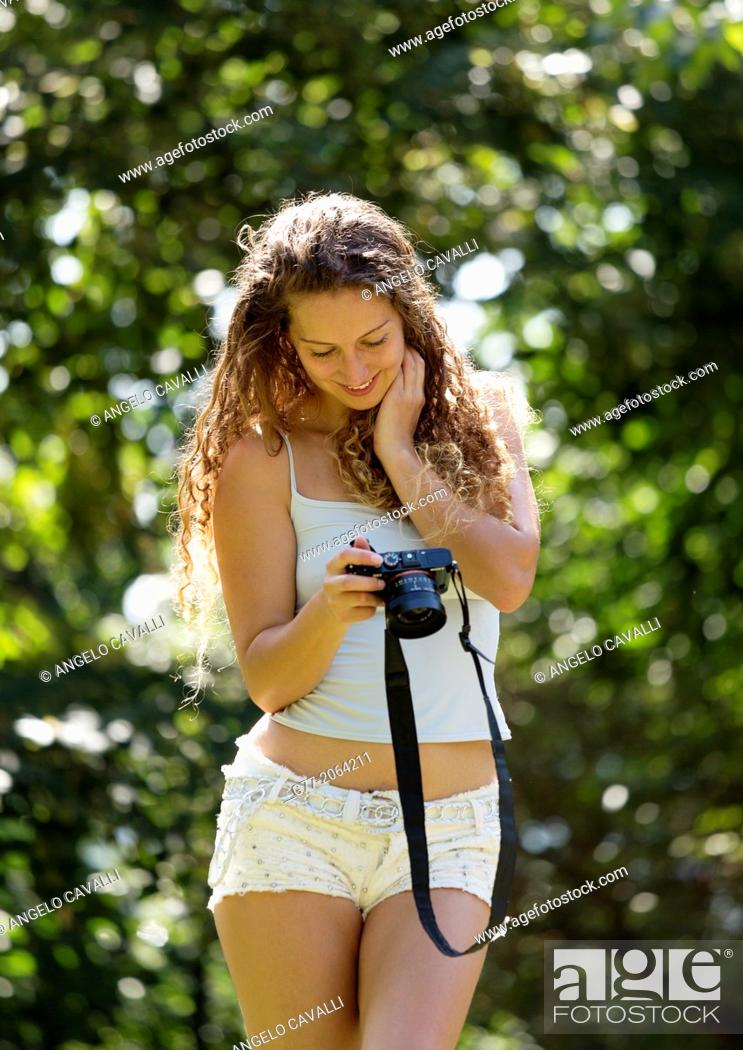 Stock Photo: Young caucasian woman 33 years outdoor with camera.