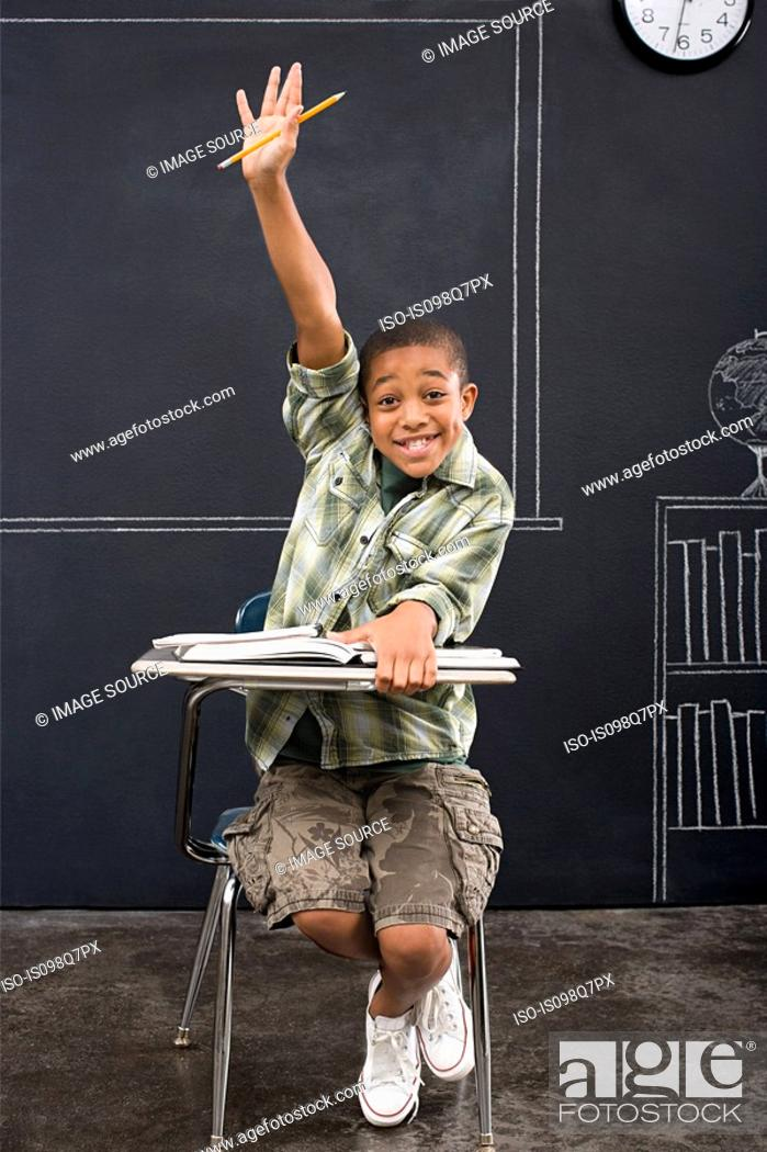 Stock Photo: Portrait of a boy with his arm raised.